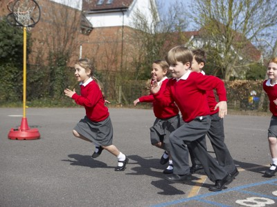 Children undertaking physical activity in a school playground