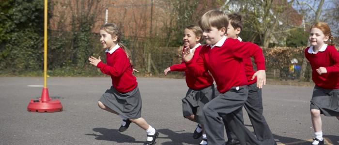 Children undertaking physical activity in a school playground